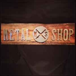 Custom Hand Cut Metal Signs on Reclaimed Wood